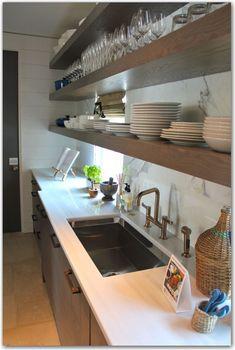 floating shelves + marble backsplash + counter in kitchen of Coastal Living Showhouse 2012