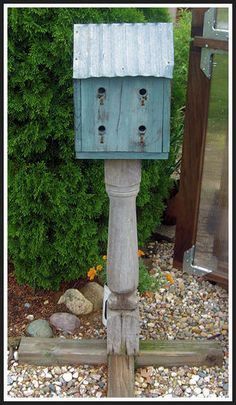 birdhouse on old porch post - Saltbox Farm Garden, Howard City, MI