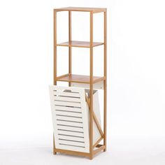 """Just what your bathroom needs! Organize your bath with this beautifully sleek bamboo shelf unit with plenty of additional storage and organizational space plus a handy hamper to keep laundry in check. Item weight: 18.00lbs Item dimensions: 13.00"""" W x 51.25"""" H x 14.63"""" L Materials: Wood - Bamboo Wood - Mdf UPC: 849179019310"""
