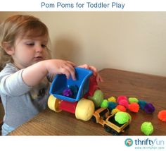 Toddlers seem naturally attracted to pom poms! Those fuzzy, colorful pom poms can be used for many things other than crafts. My son loves to use them with his toy dump trucks. He loads them up and dumps them out over and over again.
