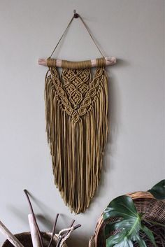 This unique piece is made by hand using tshirtyarn made of recycled fabric out of the fashion industry. The used wood is a treebranche found on the North Seacoast of the Netherlands and its surrounded dunes/forest area. The branch is cleaned and sanded where needed. ------- Macrame wall