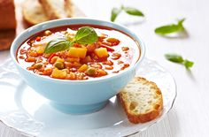 Rustic Vegetarian Soup With Bread - carrots - potatoes - onion - sugar - Italian seasoning - 14 oz. can diced tomatoes - can garbanzo beans - tomato paste - finely chopped garlic clove - frozen green peas - elbow macaroni