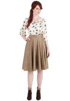 Office to See the World Skirt. After another ambitious workday, deviate from your regular route home so you and this khaki skirt can revel in that freeing feeling of success! #tan #modcloth