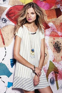Inspiration! Add a complementary fabric panel to a shirt to make a cute short dress!