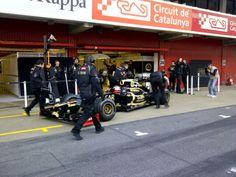 Lotus F1 team in the pits at Circuit de Catalunya