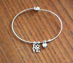"""Alex and Ani inspired - Silver Plated Charm Bracelet with petite """"LOVE"""" and Puffed Heart charms on Etsy, $10.00"""