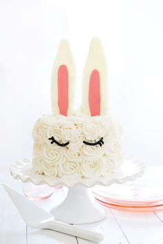 Creating a beautiful Bunny Ear cake is a lot easier than you would think! I used candy melts and whipped buttercream to create a fun and simple design that anyone can do! Does this cake look familiar? It is an updated version of a Bunny Ear Cake from my book, Surprise-Inside Cakes. (Which just so...