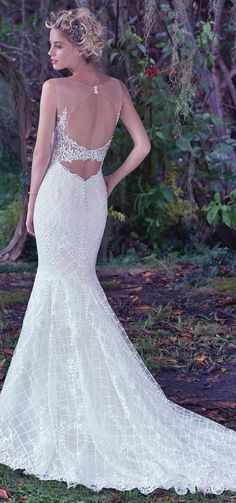 """Stunning back! """"Analeigh"""" by @maggiesottero. This unique lattice lace fit and flare wedding dress features a double keyhole back. /// #bridal #wedding #weddingdress #weddinggown #bridalgown #dreamgown #dreamdress #engaged #inspiration #bridalinspiration #bride #weddinginspiration #weddingdresses #romantic #lace #maggiesottero #maggiebride"""