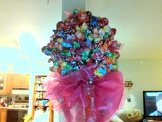 A lolli-pop topiary made from sticking over 200 lollipops into a styrofoam ball.  Made for my God Daughter's 13th birthday!