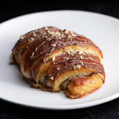 Rocher-Style Croissant - Inspiration Video - Ideas of Inspiration Video - Biting into these Ferrero Rocher inspired croissants is like taking a little trip to Paris. Pastry Recipes, Baking Recipes, Delicious Desserts, Yummy Food, Tasty, Breakfast Recipes, Dessert Recipes, Croissant Recipe, Snacks