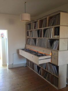 custom record shelves with slide-out turntables