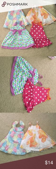 NEW LISTING! 4 dresses Great deal! All dresses have been worn but are in good condition. White and orange floral is 6-12m from baby gap. Straps don't tie up but have little bows on top. Tulle lining on bottom is about 4 inches. Shell print is 12-18m from Gymboree. Pink polka dot is 12m from carters. Heart print is 12m from Penelope Mack ltd. has one tiny spot on top (shown.) these dresses are adorable! Gymboree Dresses