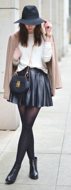 Love the color combination. I also love how the leather skirt contrasts with the softness of the knits.