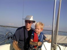 Trying to teach my grandchildren early how to sail. Look how serious he is. That's right, Sawyer. No problem.