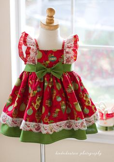 Mesmerized by this gorgeous girls Christmas dress? flutter sleeves, lace details, double layered skirt, cotton fabric, and a sash with a bow. Made in the USA by Kinder Kouture. Please allow 2 4 weeks for processing. Girls Christmas Dresses, Holiday Dresses, Christmas Girls, Green Christmas, Vintage Christmas, Little Girl Dresses, Girls Dresses, Flower Girl Dresses, Little Girl Dress Patterns