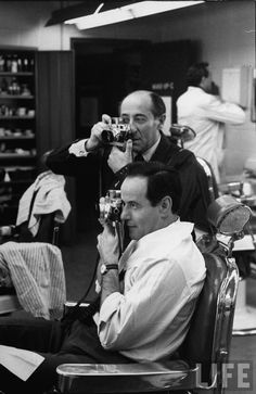 """Alfred Eisenstaedt with his Leica camera, showing actor Eli Wallach how to hone in on a shoot during rehearsal for TV's Sunday Showcase drama called """"the Margaret Bourke-White Story"""" in..."""