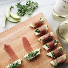 these prosciutto-wrapped apple bites are so easy to make. wrap a slice of prosciutto around an apple wedge, brie, and arugula to secure everything in place. be sure to pour yourself a glass of sauvignon blanc. appetizers with wine Edna Valley Vineyard Appetizers For Party, Appetizer Recipes, French Appetizers, Skewer Appetizers, Easy Canapes, Raclette Recipes, Canapes Recipes, Spanish Appetizers, Tapas Party