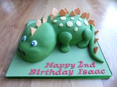 3D dinosaur cake. Carved vanilla sponge cake covered with coloured sugare paste.