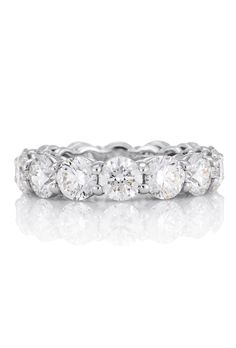Brides: De Beers. This simple and elegant full-platinum band is prong set with 0.50-carat round brilliant diamonds. Total carat weight varies depending on size.��See more info at DeBeers.com