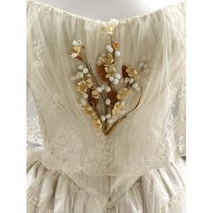 Sprig of wax and paper organge blossoms worn in front of the wedding dress. Britain 1848. Find out more http://collections.vam.ac.uk/item/O251120/wedding-dress-ensemble-unknown/