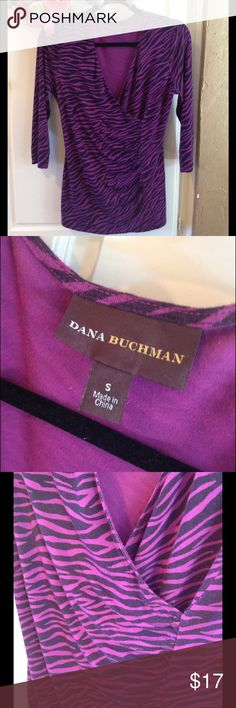 Ladies 3/4 Length Sleeve Top Dana Bachman purple top makes a bold statement without going over the top. Note the soft draping under the bustline and the vertical line in front. This top is very feminine and so fetching! Soft fabric is 95% rayon and 5% spandex. Yummy feel!  Dana Buchman Tops