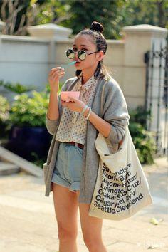 polka dot shirt, jeans shorts, grey cardigan, rounded sunnies