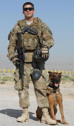 Navy Master at Arms 2nd Class Sean Brazas and MWD Sicario.
