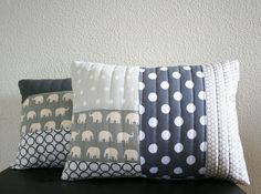 Fun way to use various nursery fabrics - make a quilted pillow like this pretty one on etsy?