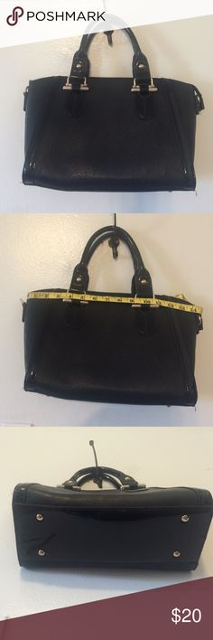"MEDIUM BLACK TOTE New; used once; faux leather and patent leather; faux gold accents; 14"" long; 9"" height; gold studs/patent leather on bottom; two zip interior pockets; two cell phone interior pockets; two interior open pockets; outside back zip pocket; zip top closure; keychain included; adjustable shoulder strap attached (never used strap; still wrapped) Bags Totes"