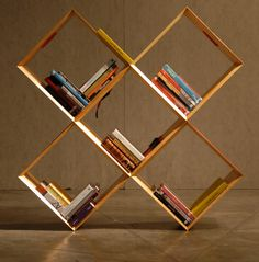 Jacob Bookcase comes from the creative group of Clark Art Center in Brazil. The group was inspired by the Jacob's Ladder toy – you know, the one from childhood where wood blocks are held together by ribbon? Made from five square wood frames that are joined with nylon strips, the piece can be configured in more ways than you could imagine.