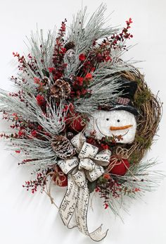 Frosty the Snowman Christmas Wreath by FloralsFromHome, Love the style and the snowman. Would be fun to make.