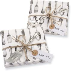 """Set of 12 printed cocktail napkins comes tied with silverplate accessory spreader that cleverly reads """"LET"""