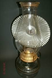 Image result for oil lamp wall mount