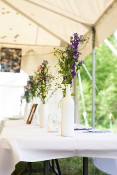 Rowley Homestead wedding Colorado weddings, painted wine bottles, lavendar in wine bottles, wedding centerpieces, Liz and Julie, photo by: Green Blossom Photography