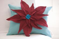 For that retro modern Christmas, my poinsettia lumbar pillow is made of beautiful and very soft turquoise brushed canvas, red felt poinsettia, individually sewn petals, and hand sewn turquoise bells. Comes with insert. Pillow measures approx. 12 x 16.  A tremendous amount of work goes into making these pillows, but the end result is worth it! All products come wrapped in ribbon, with store tag and a bow. This is especially nice for those items that are gifts!  All products are lovingly hand…