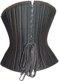 White cotton lines the inside of the corset. The corset is boned in watchspring and has a long, curved flexible busk which originally had a busk protector behind it. Busk protectors prevented the busk from snapping in two from repeated bending over, movement, etc. Black (now faded to brown) lace trimsthe top of the corset.  Kabo corsets did not use metal grommet holes but instead used matching fabric loops in which the corset lacing was inserted.