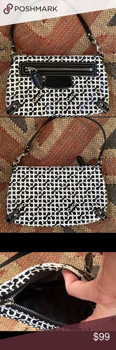 """Coach Coated Leather Handbag This is a coach coated leather handbag with Beautiful black leather trim and Silvertone accents. this bag is so adorable and it will easily fit an iPhone 6 or 6S plus. Never carried Pristine inside and out. Lined with black satin lining. 8 1/2"""" long by 5"""" tall by 3"""" deep. Coach Bags Clutches & Wristlets"""