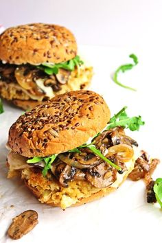 Cauliflower quinoa burgers with mushrooms and onions! A flavor packed veggie burger topped with buttery, garlicky sauteed mushrooms and onions. This will become your new favorite vegetarian burger recipe! So good! // Rhubarbarians