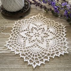 "Hello :)  I have a small doily pattern to share today called Starweave.  It's 13 rounds and measures about 8 1/2"" going across from the..."