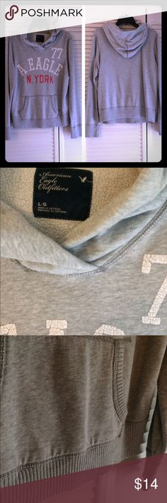 Women's American Eagle Hoodie Size large. Light gray. Worn a few times. Very small hole near the shoulder area. Very comfy. No trades. American Eagle Outfitters Tops Sweatshirts & Hoodies