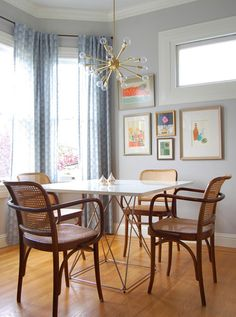 sputnik, dining room, caned chairs, Niche Interiors via Houzz  --- do not like the table, but love the rattan chairs!