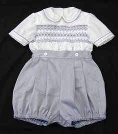 Bubbs - Boys_Romper_ This links to an English site.  The lady makes exquisite smocked clothing for children up to five years old.