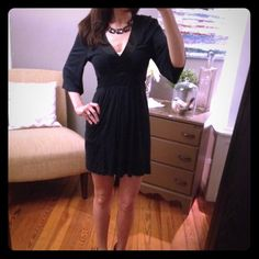 Black Express Tunic Dress Beautiful soft black v-neck tunic dress with satin detail and a long satin ribbon under the bust that ties around the back. Size M and can fit a size XS-M. This is a re-posh and in EUC. Sadly, I gained weight and now it doesn't fit. Photos and description courtesy of @mrsswans. ❤️ Express Tops Tunics