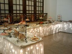 Lighted Wedding reception cookie and dessert table. Photo credit: Chris Winters.
