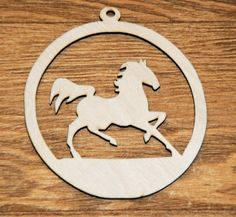 Image from http://www.artfire.com/uploads/product/1/801/31801/2831801/2831801/large/gift_tag_ornament_running_horse_wood_cut_out_3_x_3_inches_fe146c2d.jpg.