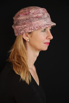 Sporty and stylish. For the woman on the run who loves hats, doesn't need her ears protected and likes the versatility of a cap. This hat has pleating extending from the front to the back o…