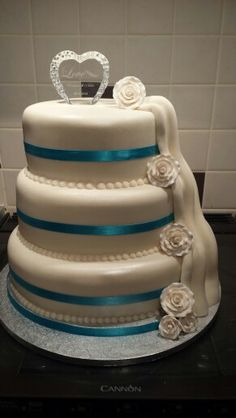 3 tier ivory and teal rose and waterfall cake