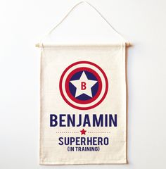 This stunning Superhero in Training Wall Banner is sure to be a great addition to any nursery or child's bedroom.