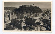 Ljubljana, Yugoslavia showing old town and castle.  Postcard from interwar period.