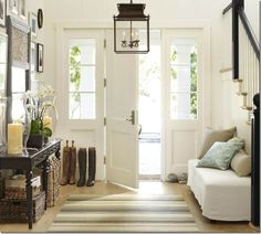 """This entry is immediately inviting. The use of household furnishings and boots by the door with a comfy rug just says """"Welcome Home!"""""""